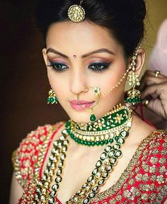 We love the strikingly gorgeous contrast of green jewelry with red outfit and the play of the jewels on this bride!  Shot by : @shadesphotographyindia . . . . . . . . . . #wedding #weddingevents #weddingfashion #weddinginspiration #shaadisaga #instagood #weddingphotography #indianbride  #instadaily  #weddingphotography #lehenga #weddinglehenga #jewelry #weddingjewelry #instafashion #indianbride #bridalfashion #bridaljewelry