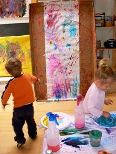 Cotton ball splat painting ~ So cool, and so brave to do indoors