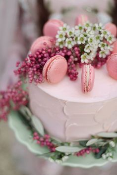 Pretty pink wedding cake with berries and macaroons