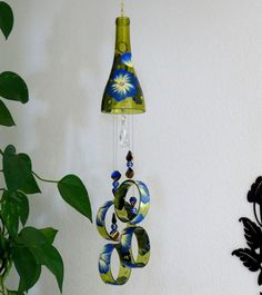 Wine bottle windchime, Amber wind chime, Blue and Yellow flowers, yard art, patio decor, recycled bottle wind chime, hand painted chime by LindasYardArt on Etsy