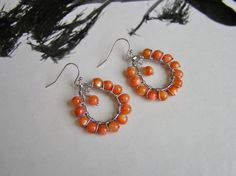 Orange Hoop Earrings with Orange Natural Shell Beads and Silver Teardrop Hoops by SmockandStone on Etsy