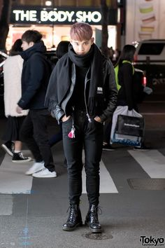 Noboru is a 20-year-old Tokyo guy with pink hair who we often see on the street in Harajuku. His look here features a leather jacket by the Swedish fashion brand Acne Studios over a ribbed Muji sweater, black skinny jeans, and patent Dr. Martens boots. His scarf is also from Acne Studios. Noboru's favorite shop is Faline Tokyo and his favorite fashion brand is Acne Studios