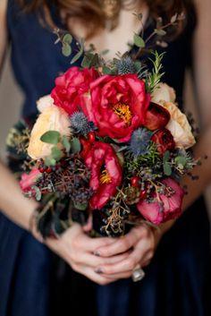 Autumn bouquet against navy blue dress