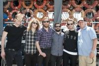 Empires gather for a photo backstage with BMI's Mark Mason at the 2014 Hangout Music Festival on May 16, 2014, in Gulf Shores, AL. (Photo by Erika Goldring)