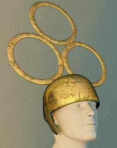 Restistution numerique d'un casque en bronze surmonté de trois anneaux découvert à Tintignac.