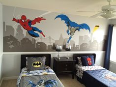 Mini Man Cave complete with Disney Fast Tracks grey paint (Walmart), Popwall Custom Batman Spider-Man Cityscape decal (EBay), Pottery Barn Kids bedding.