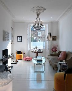 Lovely balance of white and colour, vintage and modern. And ooh what I'd give for one of those little yellow velvet chairs.