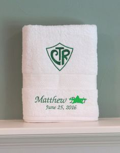 This beautiful standard size bath towel is the perfect present for any child getting baptized. Being a mom of 6, I have found that every child loves getting something with their name on it! What a wonderful way to remember their special day.  Please make sure to select a color and a font. Double check your spelling. If you select custom color combo, please tell me what color you want the shield and wording to be. (Actual towel may vary, depending on what is available. Will always be white.)…