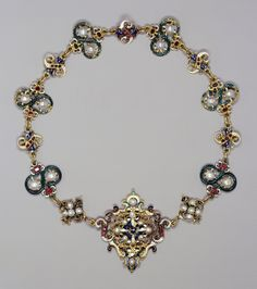Parure with necklace, brooch and earrings made from enamelled gold, pearls, rubies and emeralds, late 16th century with later additions.