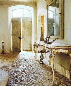 French farmhouse stone floor, wooden doors, transom window...purrrr... The stuff of dreams, right there.