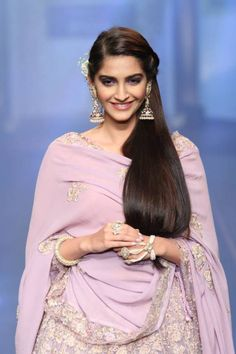 Smashing Sonam Kapoor at IIJW 2015. She wore a lilac colored lehenga choli with matching diamond jhumkas, bangle and hathphool from the collection Adaa that was launched by Birdhichand at IIJW 2015.