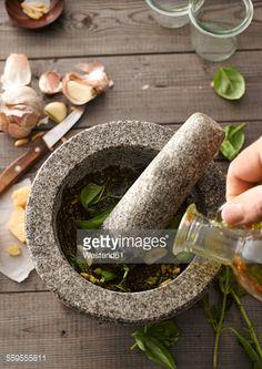 Stock Photo : Preparing basil pesto with mortar