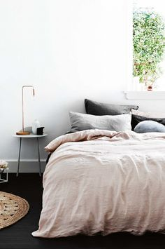 simple bedroom with blush linen bedding