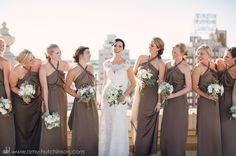 Full-length bridesmaid dresses in a neutral brown work beautifully with their green and white bouquets.   // A Memphis Peabody Wedding. Memphis Wedding Photography by Amy Hutchinson Photography. Venue: Peabody Hotel. Event design: Amy Miller Weddings + Events. #Memphis #Wedding #Photography