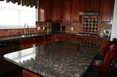 tan brown granite with dark cabinets | ... backsplash with black granite clips and a Tan Brown granite counter