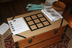 Crafting Table - we used a piece of heavy cardboard and electrical tape - so simple!