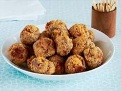Sausage Balls : Store-bought onion soup mix and pancake mix are the secret ingredients in these easy sausage balls made with pork and shredded sharp cheddar cheese.
