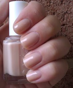 Essie 'Sandy Beach' we don't want naked nails, but a light color with adding some shine will finish your look and keep your shoot classic