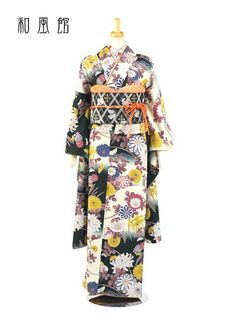 kimononagoya:A furisode with beautiful chrysanthemums in many styles and colors. The background has black and white clouds, and the flowers are in yellow, red, blue and white–these colors are bold and basic and work wonderfully against the black and white. The greenery has been colored a mauve violet instead of green–this draws attention to the yellow and the black background.