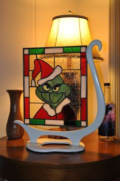 I made a stained glass Grinch with a Dr. Seuss inspired stand.