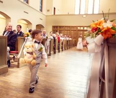 """Ring bearer and the """"ring bearer bear"""" for July wedding. Grey and Spanish orange themed. Indoor."""