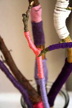 Wrapping twigs with embroidery thread.