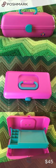 "CABOODLE organizer makeup jewelry pink purple EUC 1990s favorite CABOODLE organizer 💜💗 Perfect for makeup or jewelry. Made in the USA. Beautiful shade of pink purple, with turquoise handle, interior tray, + mirror. Remove tray + compartment to customize for your needs. Plastic. Used ONCE years ago, stored ever since. Almost 30 years old, nearly PERFECT condition, a bit of wear from age--see photos (tiny scratches on top corner, slight tarnish on metal). Measures approximately 12"" x 7"" x 6""…"