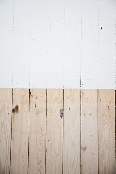Lye and soap finished wood floors. Strip in the middle is raw pine; bottom is finished floor - a natural but slightly milky white.