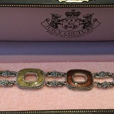 Juicy couture bracelet Juicy couture bracelet. 8 inches total length. Has green brown and tan stone-like materials in silver setting. Bracelet has been professionally cleaned.EUC  NO TRADES. NO PAYPAL. Juicy Couture Jewelry Bracelets