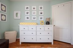 Owen's Soothing, Mint Nursery. Love that he's surrounded by pictures of hose he loves!