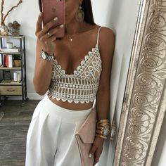 Gorgeous eyelet crop top in beige w/ white overlay. Vneck, bustier style.