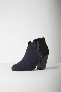 "Suede ankle boot Cushioned footbed -Exposed zipper on both sidesCap toe3 1/2"" heel height"