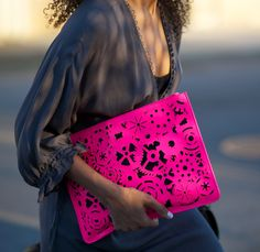 obsessed with this hot pink cut out envelope clutch