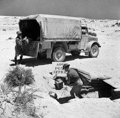 Mail being unloaded from an British Army Post Office lorry in the Western Desert, 16 July 1941.
