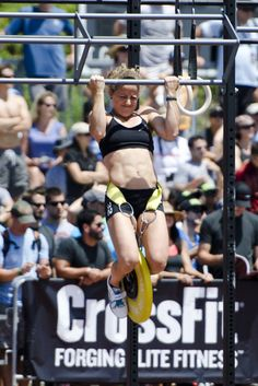 Holy Crap!!! She is one strong mamacita!!! I can't even do one pull-up with my own body weight; never mind adding weight!! Wow!!!
