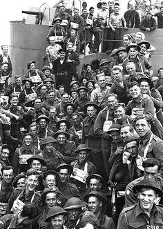 British troops and US sailors pose for the camera on board a US Navy tank landing ship D-Day