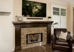 This stone fireplace is surrounded by a dark wood mantel that gives this Great Room in Seal Beach, CA a cozy feel.