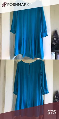 """Kate Spade dress 35"""" from shoulder to bottom of the hem. Bracelet sleeves with 2 button closure. Button closure in the back of the neck. 100% silk. Small pleats down the torso on front and back. kate spade Dresses"""