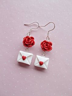 Valentines earrings with a red rose and love letter