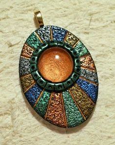 Rays pendant with glass gem by Sweet2Spicy, via Flickr - something to do with all of those glass pieces. #Polymer #Clay #Tutorials