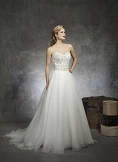 Justin Alexanderstyle 8670 - Pearls, crystals, and bugle beads accent the sweetheart neckline and  bodice of this natural waist circular cut organza ball gown. Beaded  buttons cover the back zipper and this style has a chapel length train.