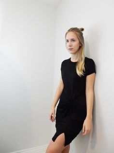 BLACK SHORT SLEEVE DRESS WITH SIDE KNOT AND FRONT SLIT.