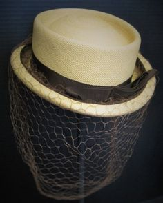 Elegant small Panama straw from the 1940's. Soft honey color hat  with dark chocolate grosgrain ribbon & full, large meshed veil.  Collection:  Susan Kohl Jankowski