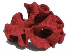 In 1997 a math professor at Cornell University, Dr. Daina Taimina, discovered that it was possible to create a physical model of a hyperbolic plane using the art of crochet. Many mathematicians tho...