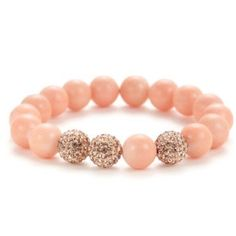 """Very Me Peach Jade Bracelet Very Me's colorful beaded bracelets give the phrase """"arm candy"""" a whole new meaning. Jewelry designers Olga and Julie combine Swarovski crystals, woven cord, glittering gold charms, and polished beads made from natural gemstones and minerals to create their striking pieces. Peach Jade stretch bracelet with pave rose crystal center details. 2"""" diameter, .45"""" wide. No trades. Very Me Jewelry Bracelets"""