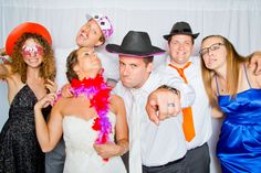 Our couples always have too much FUN at their Photo Station! Photo by Kelly M. #MinneapolisWeddingPhotographers #PhotoStation #Goofy #Silly #WeddingInspiration