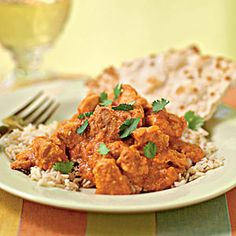 A take on the Indian dish murgh makhani, this Indian cashew chicken recipe features a thick sauce flavored with Indian spices and spice blends such as garam masala, coriander, ginger, and ground red pepper.  Serve over brown basmati rice or with naan flatbread.