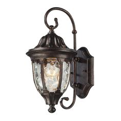 The Beauty Of Water Glass Is Encased In A Regal Bronze, Cast Aluminum Frame With A Decorative Top Cap That Has Ribbed Detailing Which Adds To The Classic Allure. Complete Your Outdoor Presentation Wit                                                                                                                                                      More