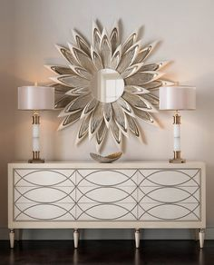 Luxurious entryway to make a statement with a combination of Console with storage, Lamps and Focal Artwork with Mirror. (Find Here)