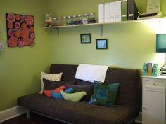 for the loft area love the idea of a futon with a shelf above